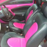 car seats reupholstered with pink and black leather fabric