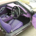retro car interior re-upholstered with purple leather